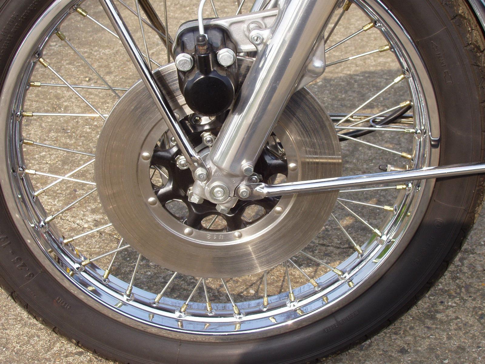 Honda CB500 Four - 1971 - Front Brake, Disc, Wheel, Spokes and Fork Lower.