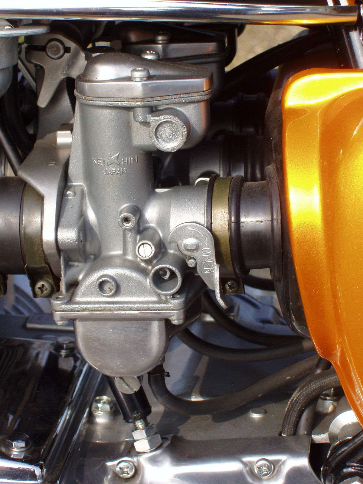 Honda CB500 Four - 1971 - Carburettor, Carb, Side Panel, Carb Rubber and Inlet.