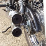 Honda CB500 Four - 1971 - Chain Guard, Mufflers, Swing Arm, Chain Adjuster and Wheel.