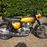 Honda CB750 K1 - 1970 - Right Side View, Mufflers, Fenders, Gas Tank, Headlight Ears and Flashers.