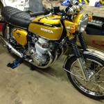 Honda CB750 K1 - 1970 - Tank and Side Panels, Front Wheel, Spokes, Wheel Rim, Forks and Headlight.