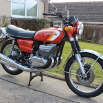 Suzuki GT380 - 1973 - Main Stand, Frame, Mufflers, Engine and Forks.