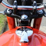 Suzuki GT380 - 1973 - Gas Cap. Top Yoke, Steering Stem Nut and Handlebars.