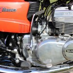 Suzuki GT380 - 1973 - Motor and Transmission, Kick Start, Brake Lever, Ram Air Heads and Cables.