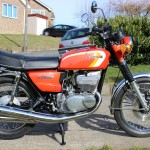 Suzuki GT380 - 1973 - Tank and Side Panels, Exhausts, Shock Absorbers and Stand.