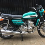 Suzuki GT750J - 1972 - Frame and Forks, Wheels, Brake and Tyres, Seat Cover, Gas Tank, Side Panel, Radiator Guard, Centre Stand and Seat Trim.
