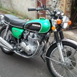 Honda CB500 Four - 1972 - Mufflers, Motor, Forks, Suspension, Honda Badge and Grips.