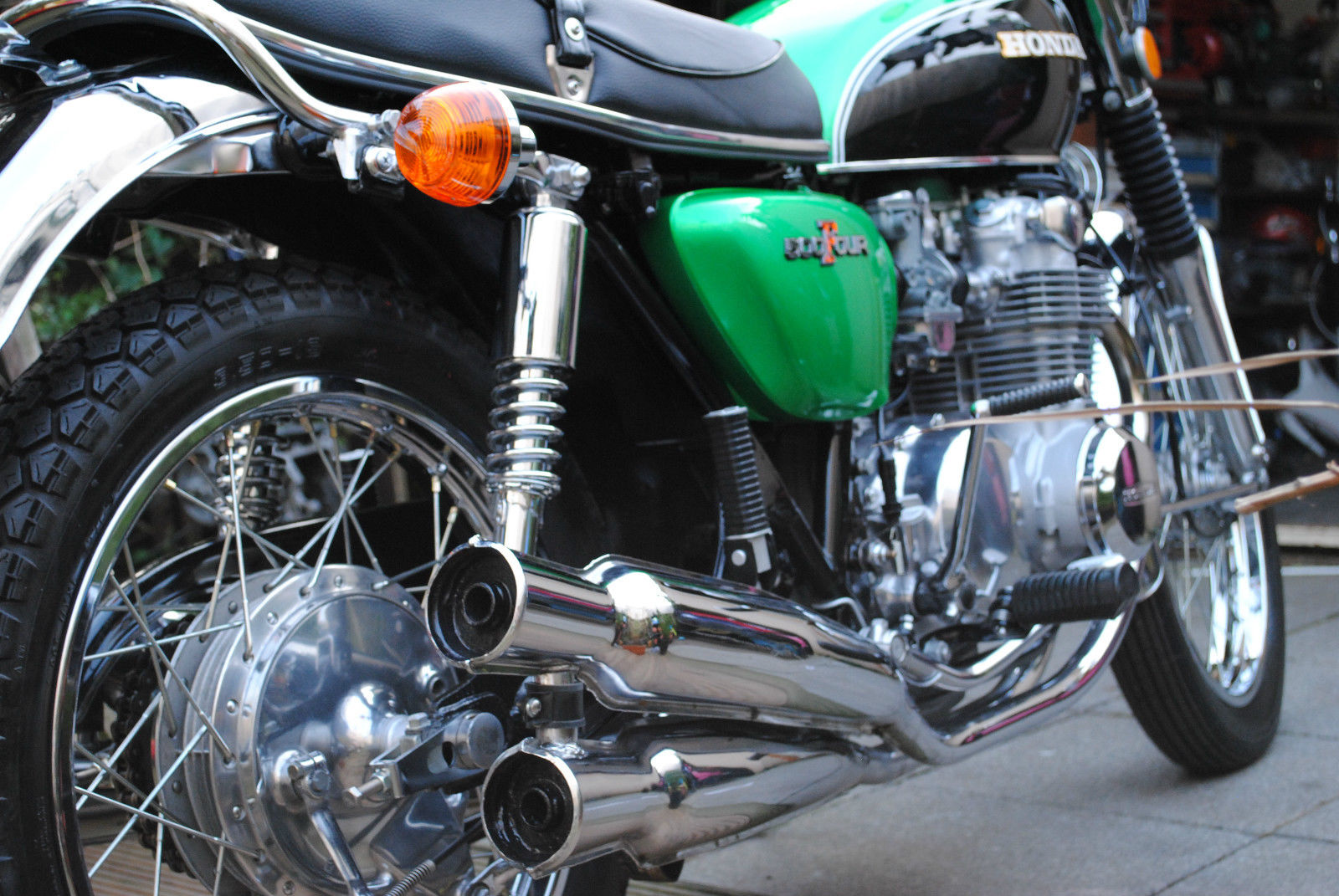 Honda CB500 Four - 1972 - Exhausts, Shock Absorber, Rear Brake Hub, Rear Footrest, Indicator and Seat Trim.