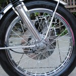 Honda CB500 Four - 1972 - Front Wheel, Spokes, Fork Bottoms, Disc Brake and Caliper.