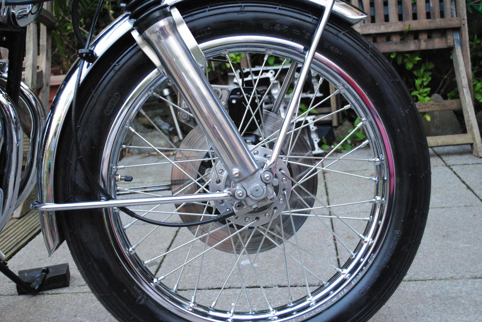 Honda CB500 Four - 1972 - Front Wheel, Spokes, Fork Bottoms, Disc Brake and Caliper.