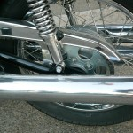 Kawasaki H1 500 - 1974 - Swing Arm, Exhaust Muffler, Chain Guard, Chain and Sprocket.