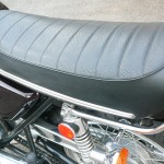 Kawasaki H1 500 - 1974 - Seat, Grab Rail, Frame, Shock Absorber, Rear Wheel and Chain Guard.