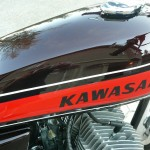 Kawasaki H1 500 - 1974 - Fuel Tank, Kawasaki Decal, Cylinder Heads and Spark Plugs.