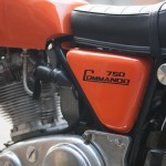 Norton Commando - 1972 - Footrest Plate, Primary Chain Case and 750 Commando Decal.
