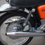 Norton Commando - 1972 - Rear Wheel. Shock Absorber, Rear Mudguard, Stainless Spokes and Wheel Rim.
