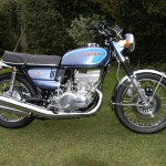 Suzuki GT550 - 1973 - Right Side View, Ram Air, Fenders, Wheels, Headlight Ears and Reflectors.