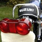Suzuki GT550 - 1973 - Rear Light, Lens, Grab Rail, Seat Cover, Shock Absorber, Rear Mudguard and Bracket.