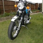 Suzuki GT550 - 1973 - Headlight, Indicators, Front Fender, Front Wheel, Side Stand and Forks.