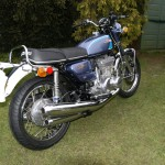 Suzuki GT550 - 1973 - Exhaust System, Indicators, Shock Absorbers, Rear Mudguard and Rear Wheel.