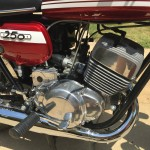 Suzuki T250 - 1972 - Clutch Cover, Footrest, Cylinder Head and Barrels.