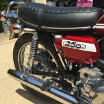 Suzuki T250 - 1972 - Side Panel Badge, Oil Tank Badge, Seat, Seat Trim, Oil Pump, Rear Wheel and Rear Footrest.