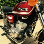 Suzuki T250 - 1972 - Horn, Exhausts, Forks Tubes, Engine Cases and Oil Tank,