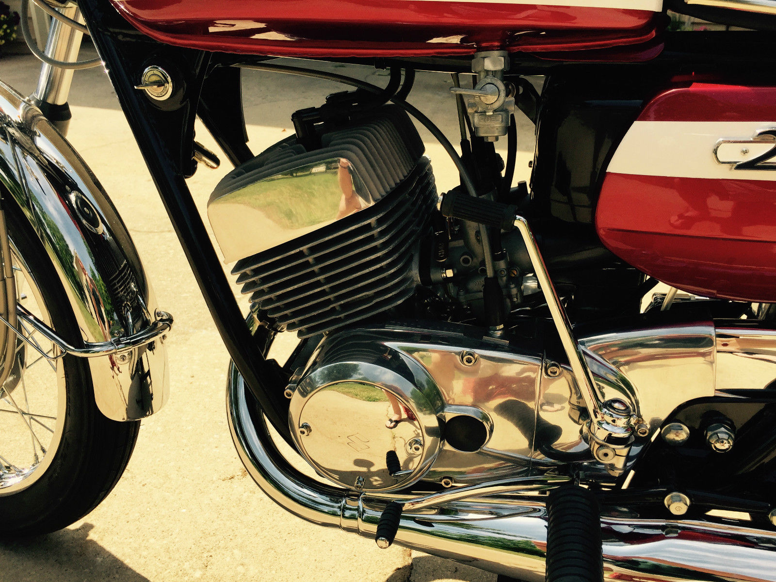 Suzuki T250 - 1972 - Points Cover, Kick Start, Polished Engine Case, Gear Change and Fuel Tap.