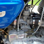 Suzuki T500 - 1973 - Oil Pump Cover, Tacho Cable, Oil Filler Cap and Inlet.