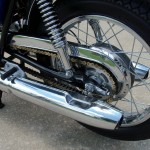 Suzuki T500 - 1973 - Chain Guard, Shock Absorber, Rear Footrest and Exhaust.