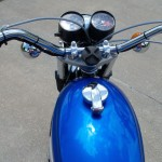 Suzuki T500 - 1973 - Gas Tank, Gas Cap, Handlebars, Steering Damper and Clocks.