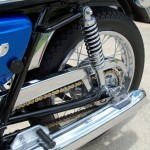 Suzuki T500 - 1973 - Swing Arm, Chain, Side Panel and Side Panel Knob.