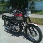 Triumph Bonneville - 1962 - Front Wheel, Forks, Headlight, Handlebars and Mirror.