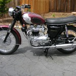 Triumph Bonneville - 1970 - Left Side View, Exhaust, Mudguard, Lucus Rear Light, Exhaust Silencer, Seat Trim, Headlight, Frame and Forks.