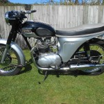 Triumph Speed Twin - 1964 - Left Side View, Headlight, Handlebars, Switches, Primary Chain Case, Kick Stand, Frame, Cables and Carburettor.