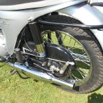 Triumph Speed Twin - 1964 - Rear Wheel, Brake Rod, Shock Absorber, Chain Guard, Silencer and Footrest.